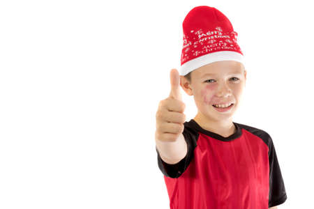 pre teen boy: Pre-teen boy wearing a santa hat looiking happy isolated on white