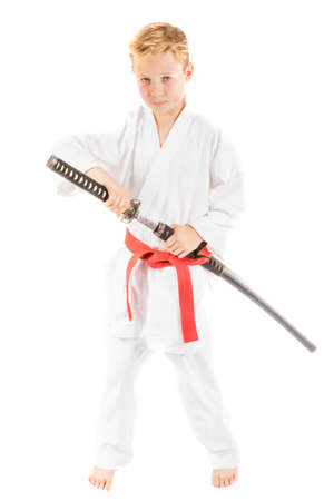pre teen boy: Pre-teen boy with a samurai sword isolated on a white background