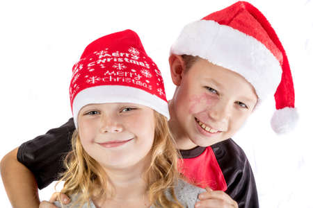 pre teen boy: Happy siblings embrance for christmas isolated on white background