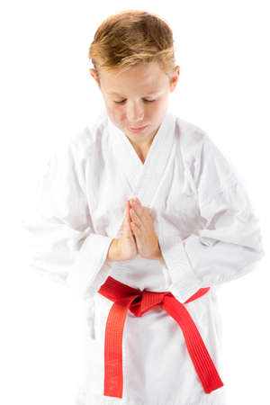 pre teen boy: Pre-teen boy in martial arts uniform doing martial arts