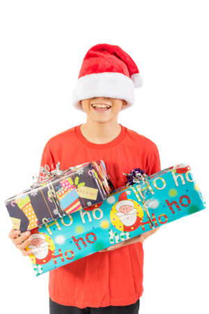 Young teenage boy holding  Christmas gifts, isolated on white background Stock Photo