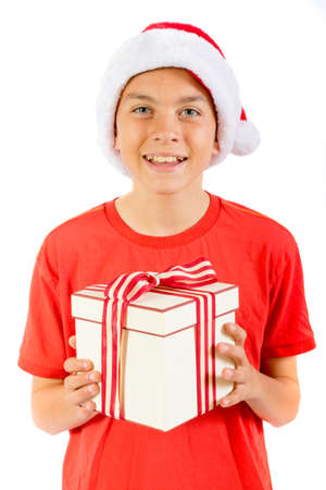 Young teenage boy holding a Christmas gift, isolated on white background