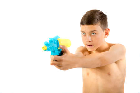 Young teenage boy playing with water guns isolated on a white background Stok Fotoğraf