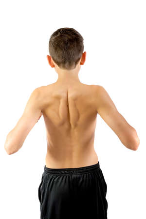 Shirtless teenage boy flexing his back muscles isolated on a white background