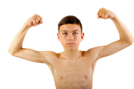 Shirtless teenage boy flexing his muscles isolated on white background