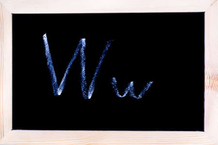 Blackboard with white chalk writing showing capital and lowercase W