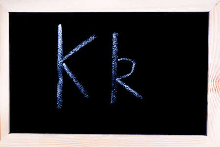 Blackboard with white chalk writing showing capital and lowercase K