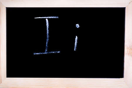 Blackboard with white chalk writing showing capital and lowercase I Stock Photo