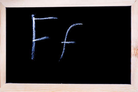 Blackboard with white chalk writing showing capital and lowercase F