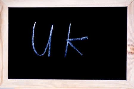 Blackboard with white chalk writing showing UK Stock Photo