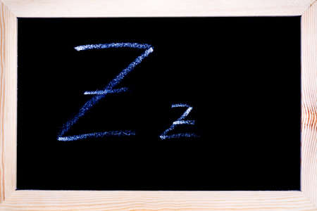 Blackboard with white chalk writing showing capital and lowercase Z