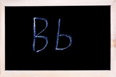 Blackboard with white chalk writing showing capital and lowercase B