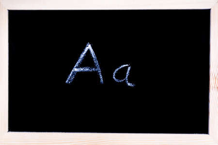 Blackboard with white chalk writing showing capital and lowercase A Stock Photo