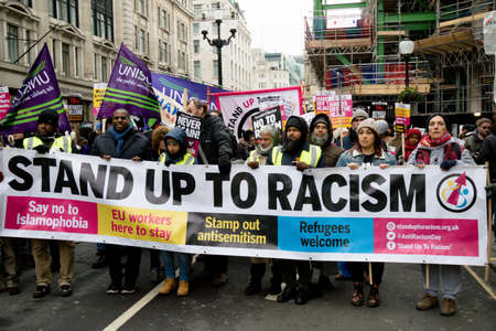London, United Kingdom, 17th March 2018:- The Stand Up to Racism march through central London from the BBC to outside Downing Street Redactioneel