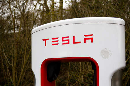 Reading, United Kingdom, 31th March 2018:- A Tesla Model S charges at the Tesla Supercharger station at Reading's Green Park. Superchargers allow for rapid charging compared to home charging. Editorial