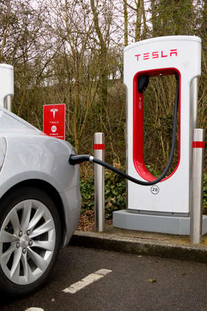 Reading, United Kingdom, 31th March 2018:- A Tesla Model S charges at the Tesla Supercharger station at Reading's Green Park. Superchargers allow for rapid charging compared to home charging.