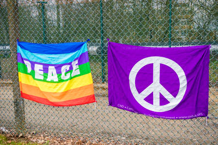 Aldermaston, United Kingdom, 1st April 2018:- CND protesters gather outside the main gate to the AWE where Britain's nuclear warheads are made, on the 60th anniversary of the first CND march in 1958 Editöryel