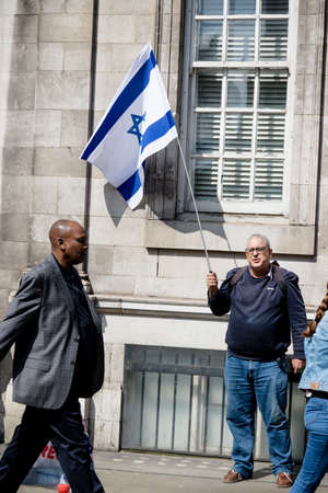 London, United Kingdom, 14th April 2018:- A lone Pro Israel protester opposite a gathering of pro Palestine protesters, near the Israeli Embassy in London.