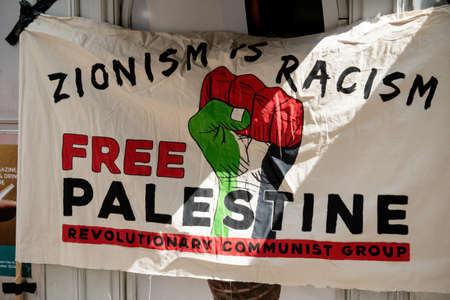 London, United Kingdom, 14th April 2018:- Banner at a gathering of protesters along Kensington High Street, near the Israeli Embassy in London to protest the ongoing occupation of Palestine.