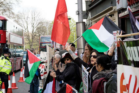 London, United Kingdom, 14th April 2018:- Protesters gather along Kensington High Street, near the Israeli Embassy in London to protest the ongoing occupation of Palestine. Editorial