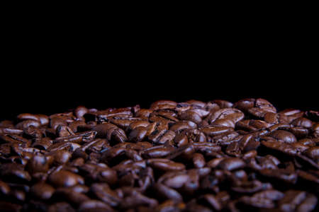 Whole roasted coffee beans with copy space Фото со стока