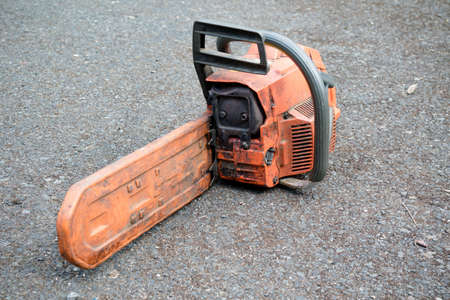 A well used chainsaw used by a tree surgeon Stock Photo