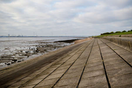The concrete sea front on the Isle of Grain, Kent, UK Stock Photo