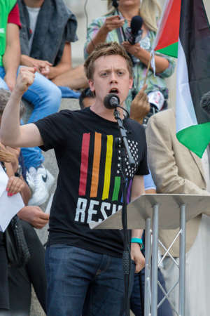 London, United Kingdom, 13th July 2018: Journalist Owen Jones, speaks at an anti Trump Rally in central London Editorial