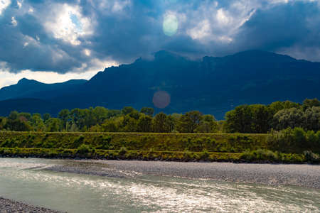 A view of the river Rhine across the international border between Liechtenstein and Swizerland