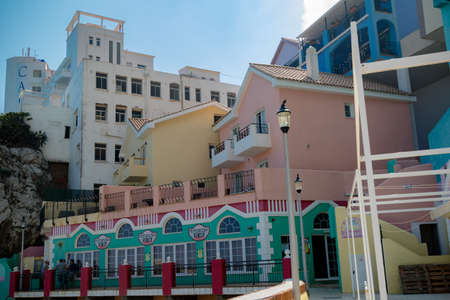 Gibraltar, United Kingdom, 2nd October 2018:- Colourful buildings along the seafront in Catalan Bay, Gibraltar. Gibraltar is a British Overseas Territory located on the southern tip of Spain. Editorial