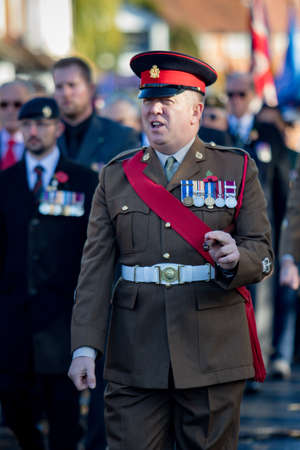 Sandhurst, United Kingdom, 11th November 2018:- British Soldiers march to Sandhurst War Memorial on the 100th Anniversary of the Armistice that ended the First World War 報道画像