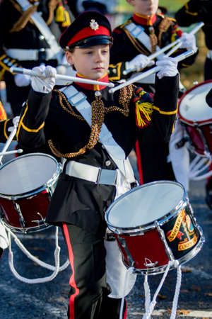 Sandhurst, United Kingdom, 11th November 2018:- Cadets from Sandhurst Corps of Drums march to Sandhurst War Memorial on the 100th Anniversary of the Armistice that ended the First World War