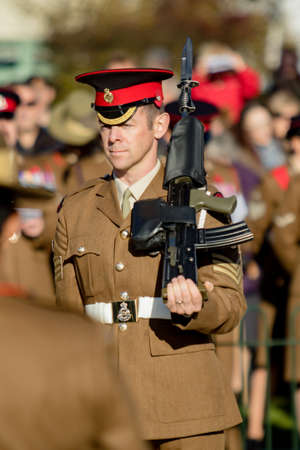 Sandhurst, United Kingdom, 11th November 2018:- A British Soldier stands guard at Sandhurst War Memorial on the 100th Anniversary of the Armistice that ended the First World War