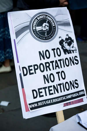 London, United Kingdom, November 17th:- Anti deportation placard at the Stand Up To Racism march through central London from the BBC to near Downing Street in Whitehall