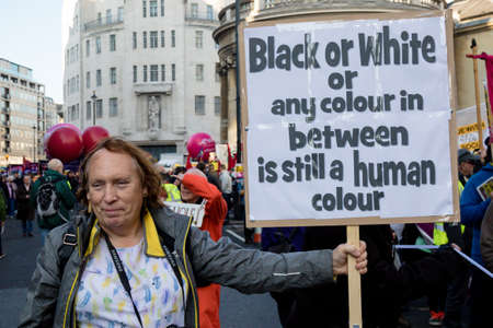 London, United Kingdom, November 17th:- Anti racist proteser at the Stand Up To Racism march through central London from the BBC to near Downing Street in Whitehall