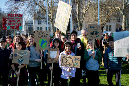 London, UK, United Kingdom 15th February 2019:- Striking school aged children in central London over climate change holding placards Editorial