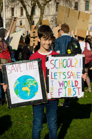 London, UK, United Kingdom 15th February 2019:- Striking school aged children in central London over climate change holding placards Redakční