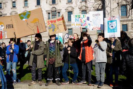 London, UK, United Kingdom 15th February 2019:- Striking school aged children in central London over climate change holding placards Redakční