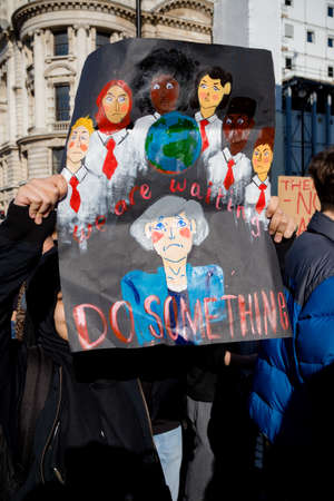 London, UK, United Kingdom 15th February 2019:- Striking school aged children in central London over climate change holding a placard Editorial
