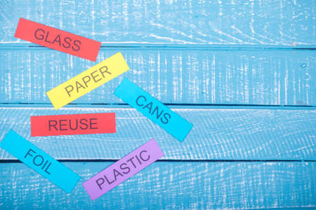 Recycle concept showing on waste items listed with reuse a blue weathered background with copy space