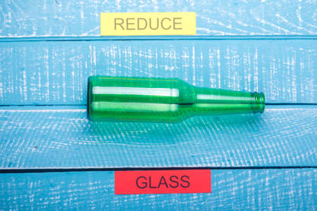 Recycle concept showing glass & reduce on a blue weathered background Stok Fotoğraf