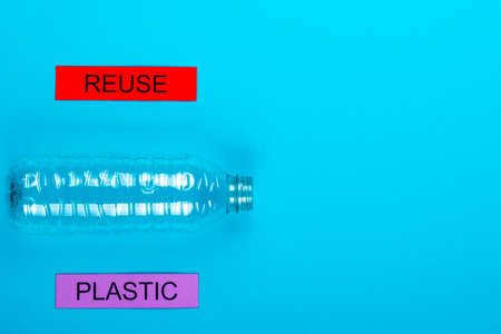 Recycle concept showing a plastic bottle on a blue background