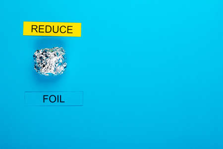 Recycle concept showing foil on a blue background