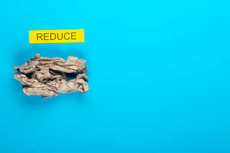 Recycle concept showing paper on a blue background