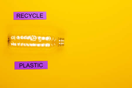 Recycling concept showing recycle & plastic  on a yellow background Stok Fotoğraf