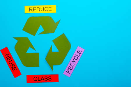 Recycle concept showing the green recycle logo with reduce, reuse, recycle & glass on a blue background Stok Fotoğraf