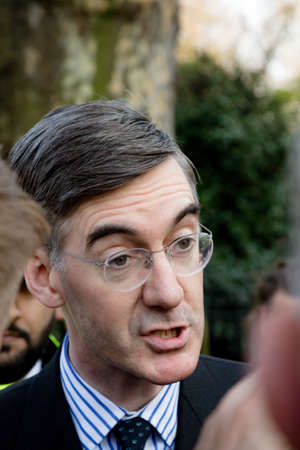 London, United Kingdom, March 29th 2019:- Conservative Member of Parliament Jacob Rees-Mogg leading supporter of Briexit leaves the British Parliament after voting against the withdrawl agreement