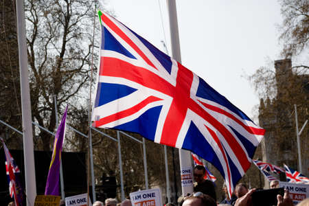 London, United Kingdom, March 29th 2019:- Pro Brexit protesters outside the British Parliament demanding a No Deal Brexit leaving on WTO terms fly a Union Flag Publikacyjne