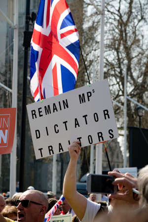 London, United Kingdom, March 29th 2019:- Pro Brexit protesters outside the British Parliament demanding a No Deal Brexit leaving on WTO terms fly British flags 에디토리얼