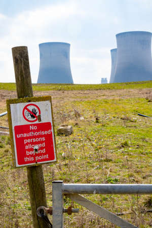 Didcot, United Kingdom, March 28th 2019:- The cooling towers of Didcot Power Station in Oxfordshire along with a warning sign Redakční